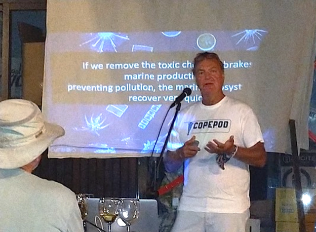 Howard explains why chemicals are bad for plankton in front of a presentation that says: if we remove the toxic chemical brakes marine production prevention pollution, the marine ecosystem will recover very quickly